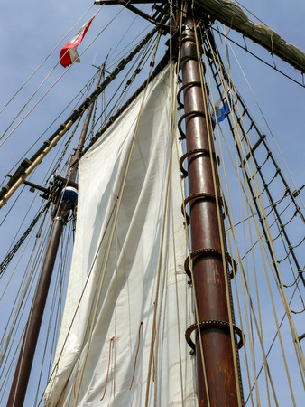 Close-up of the sail and the mast of a schooner