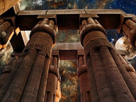 photomontage: Photo-montage of columns of the Luxor Temple, Moon and Tarantula Nebula background
