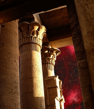 photomontage: Photo-montage of the Sobek Temple columns in Kom-Ombo and Eagle Nebula (Elements of this image furnished by NASA) Stock Photo