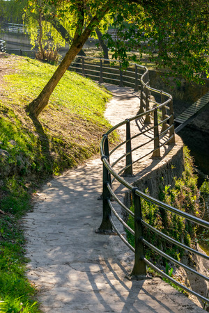 sinuous: Benches and sinuous footpath for a walk in the park Stock Photo