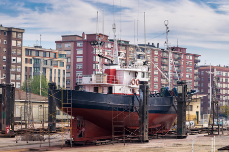 keel: Starboard view of a fishing boat in a shipyard for maintenance Stock Photo