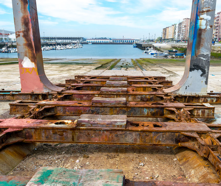 slipway: Detail of the old and rusty machinery a disused shipyard ramp Stock Photo
