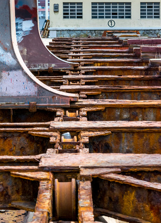 drydock: Detail of the old and rusty machinery a disused shipyard ramp Stock Photo