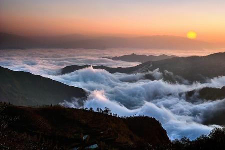 Mountain, clouds and  sunrise - The China Yuanyangtitian beautiful scenery. photo