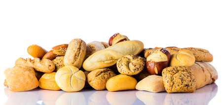 healty: A pile of baked bread, bun, baguette isolated on white background. concept for healty cereal food