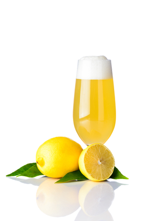 One glass of radler beer with lemon isolated on white background