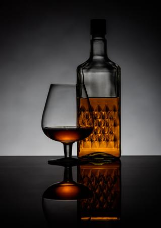 cognac: Cognac brandy in a glass and bottle