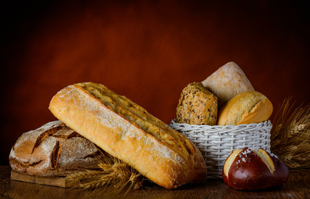stillife: bread in traditional still life with bun basket  and wheat.