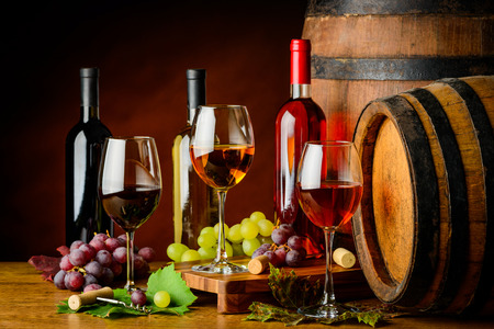 cabernet sauvignon: pinot gris, Cabernet sauvignon and pino noir in cellar with barrels Stock Photo