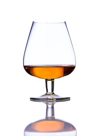 cognac: One glass of cognac brandy isolated on white background