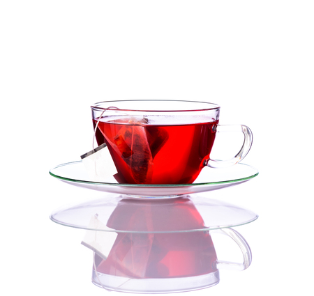 stillife: One glass of red tea in glass-cup with tea-bag isolated on white background Stock Photo