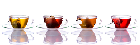 Collage of four Tea cups with tea-bags isolated on white background Фото со стока