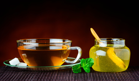 stillife: Cup of green Tea and a cup of Honey in traditional still-life