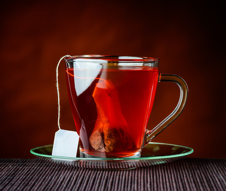 teabag: Glass Tea Cup with Tea-Bag in traditional still-life Stock Photo