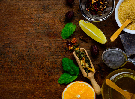 tabletop: Top-view of tea-ingredients on a wooden Table-top