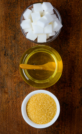 top view of three types of Sweeteners on wooden table-top