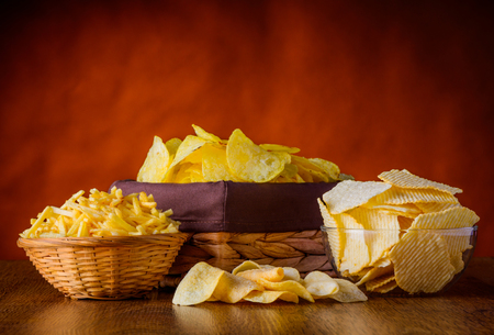junkfood: different types of Potato junk-food, chips and sticks in still life Stock Photo