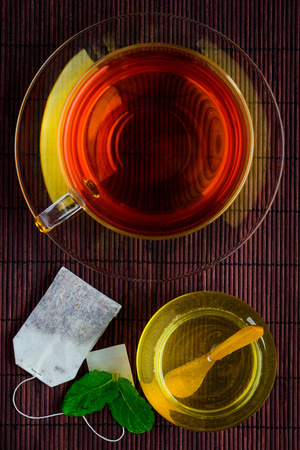 topdown: Top-down-view of Tea cup with honey sweetener and tea-bag Stock Photo