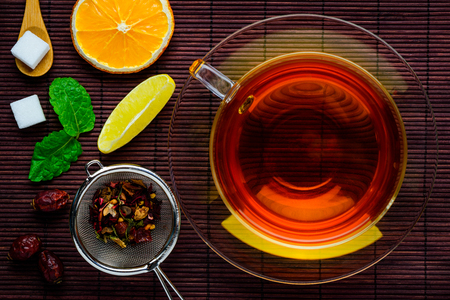 topdown: Cup of black tea with some tea ingredients in Top-down view
