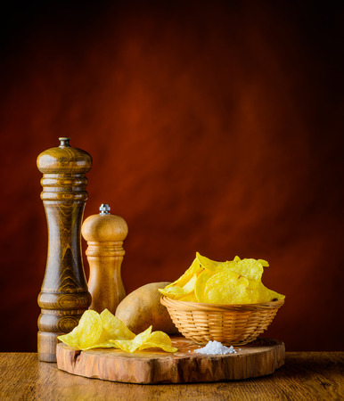 salty: Salty Potato chips and salt in still life