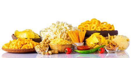 Different types of Junk-food on white background. Potato Chips, peanuts, and popcorn