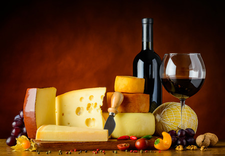 different types of cheese: Different types of Cheese and red wine in Glass and Bottle