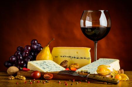 gorgonzola: Blue Cheese, gorgonzola, morbier, grapes and red glass wine Stock Photo