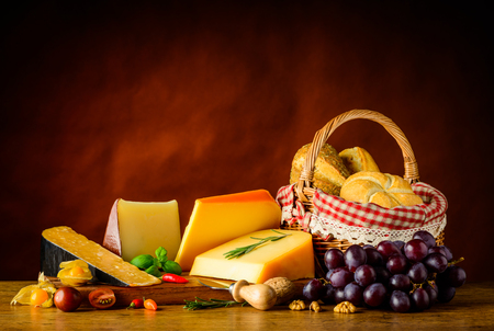 hard cheese: Hard Cheese Gauda, Cheddar and Edam with basket bun and grapes