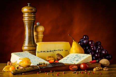 gorgonzola: Blue Cheese Gorgonzola, Morbier and fruits on wooden table Stock Photo