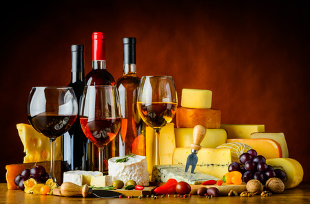 Three bottles and glasses of wine with Food and cheese Stock Photo