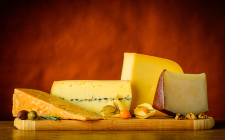 hard cheese: Gouda cheese and other hard cheese in still life with food Stock Photo