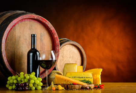 wine grape: Barrel wine with red wine in glass and bottle with food and cheese