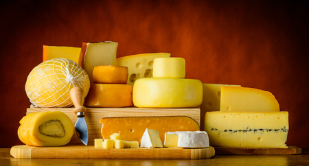 hard cheese: Hard cheese, gouda, morbier emmental in still life with food Stock Photo