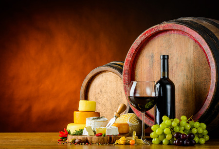 redwine: Red-wine with cheese and barrel in still lif