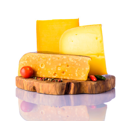hard cheese: Hard cheese, colby, gouda, and swiss-cheese on wooden chopping board with pepper