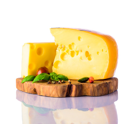 emmental: Yellow swiss emmental cheese on white background