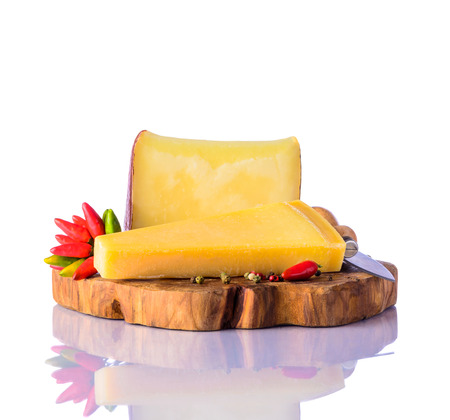hard cheese: Hard Cheese gouda and parmesan with pepper and cheese-knife on white background
