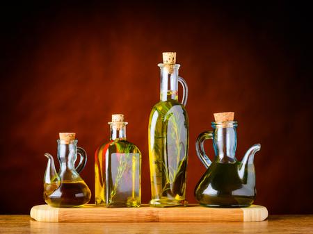 Four Bottles of extra virgin olive oil in still life Stock Photo