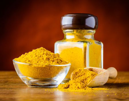 glass jar of curry powder Food spice. South Asian cuisine.