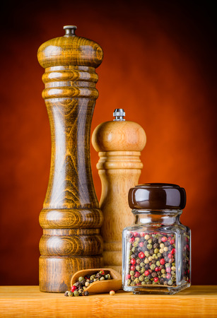 peppercorn: White, green, black and Peppercorn in a jar and two pepper mills grinders Stock Photo