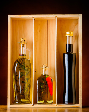 balsamic vinegar: Cooking oil and balsamic vinegar seasoning in a wooden box