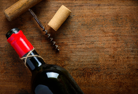 cork screw: Wine Bottle, corkscrew and cork on wooden background with copy space Stock Photo