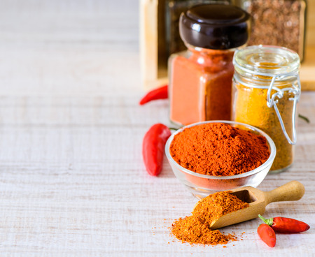curry powder: Jar papprika powder and curry powder cooking spices with copy space