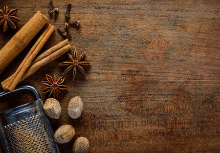 Spices Cinnamon, starnise and nutmeg on wooden background with copy space