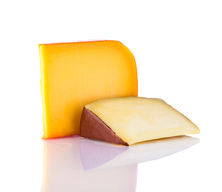 hard cheese: yellow Gouda hard cheese isolated on white background