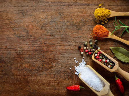 curry powder: Copy space with different Spices. Salt, curry powder, peppercorn, paprika.
