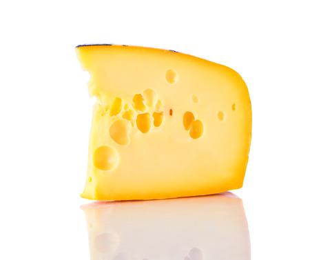 swiss cheese: Emmentaler Switzerland swiss cheese isolated on white background. Stock Photo