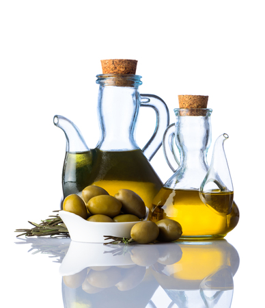 extra virgin: Botlles of extra virgin olive oil and olives on white background with reflection Stock Photo