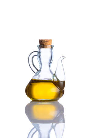 extra virgin: A Bottle of Extra Virgin Olive Oil in traditional bottle isolated on white background and reflection Stock Photo