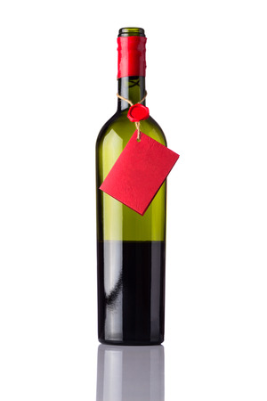 half full: Bottle of Red white opened half full with red label isolated on white background
